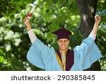 young graduation man holding... | Shutterstock . vector #290385845