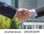 two businessmen shaking hands | Shutterstock . vector #290392049