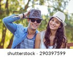 cute couple in the park on a... | Shutterstock . vector #290397599