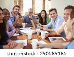 Small photo of Group Of Office Workers Meeting To Discuss Ideas