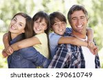 portrait of family in garden | Shutterstock . vector #290610749