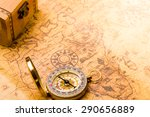 compass lying on vintage map... | Shutterstock . vector #290656889