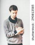 man writing in a notebook | Shutterstock . vector #290813585
