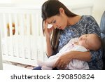 Small photo of Tired Mother Suffering From Post Natal Depression