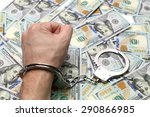 Hand In Handcuffs On A Pack Of...