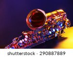 Golden Saxophone On Purple...