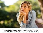 thoughtful woman sitting alone... | Shutterstock . vector #290942954
