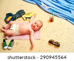Child Lies On A Towel On The...