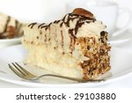 Pecan cream sponge cake, with a cup of coffee. - stock photo
