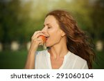 happy young woman eating apple... | Shutterstock . vector #291060104