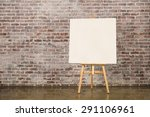 Easel With Blank Canvas On A...