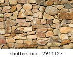 Old brown colors stone wall - stock photo