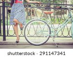 young girl dressed in a striped ... | Shutterstock . vector #291147341