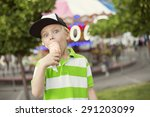 Cute Boy Fully Enjoying An Ice...