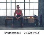 resting her elbows on her knees ...   Shutterstock . vector #291254915
