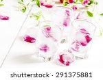 ice cubes with rose petals on... | Shutterstock . vector #291375881