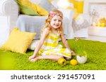 little girl sitting on a green... | Shutterstock . vector #291457091