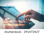 city and hands using tablet... | Shutterstock . vector #291472427