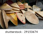 Asian conical hats traditionally worn by rice farmers - stock photo