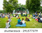 "Small photo of MOSCOW - JUNE 20, 2015: People attend open-air concert on XII International Jazz Festival ""Usadba Jazz"" in Tsaritsyno Park on June 20, 2015 in Moscow"