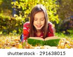 Girl Lying On Fallen Leaves  I...