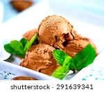 Stock photo ice cream scoops with chocolate topping brown chocolate icecream served with dark chocolate 291639341