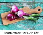 Fresh Purple Onion On A Wooden...