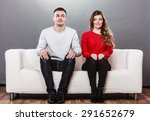 Shy Woman And Man Sitting On...