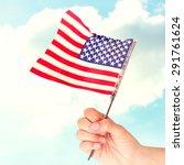 hand waving american flag... | Shutterstock . vector #291761624