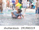 A Boy Playing With Water In...