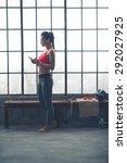 standing by a wooden bench... | Shutterstock . vector #292027925