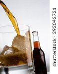 pouring glass of cold cola | Shutterstock . vector #292042721