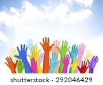 colorful arms raised volunteer... | Shutterstock . vector #292046429