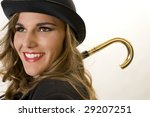 Blonde Fashion Model in Bowler Hat and Man's Raincoat. - stock photo
