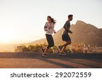 young couple jogging early in... | Shutterstock . vector #292072559