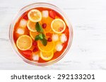 Small photo of Fruity punch in glass bowl on wooden table, top view