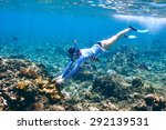 Woman With Mask Snorkeling In...