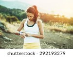 woman using activity tracker or ... | Shutterstock . vector #292193279