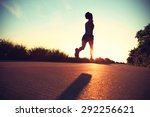 young fitness woman running on... | Shutterstock . vector #292256621