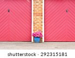 Pot Of Pink Flowers In Front O...