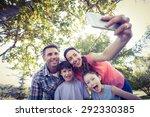 Happy Family In The Park Takin...