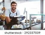 smiling worker posing behind... | Shutterstock . vector #292337039