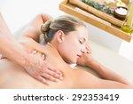 woman enjoying a back massage... | Shutterstock . vector #292353419