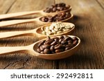 coffee beans in spoons on... | Shutterstock . vector #292492811