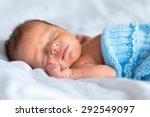 Newborn Baby Boy Sleeping In Bed