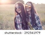 two happy young woman in... | Shutterstock . vector #292561979