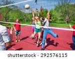 Small photo of Happy teenage kids play volleyball outside