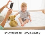 happy mother taking a picture... | Shutterstock . vector #292638359
