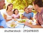 Multi Generation Family Eating...