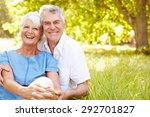 senior couple sitting on grass... | Shutterstock . vector #292701827